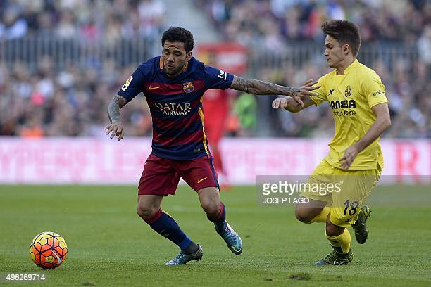 Barcelona's Brazilian defender Dani Alves vies with Villarreal's midfielder Denis Suarez during the Spanish league football match FC Barcelona vs...
