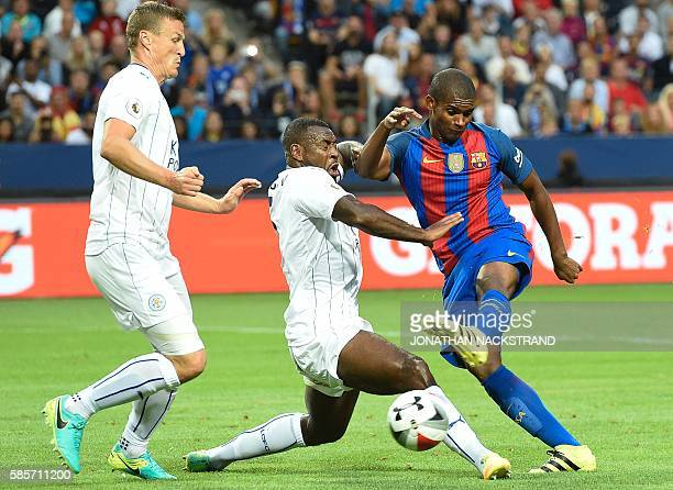 Barcelona's Brazilian defender Marlon Santos vies with Leicester's English defender Danny Simpson during the 2016 International Champions Cup...