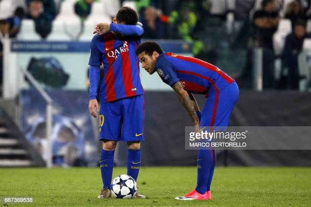 Barcelona's Brazilian forward Neymar and Barcelona's Argentinian forward Lionel Messi react during the UEFA Champions League quarter final first leg...