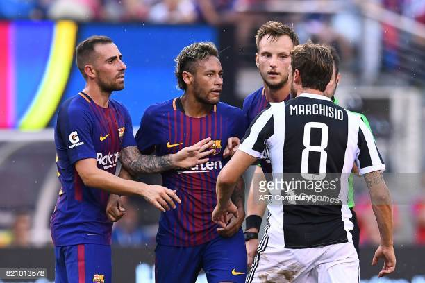 Barcelona's Brazilian forward Neymar argues with Juventus' midfielder from Italy Claudio Marchisio during the International Champions Cup match...