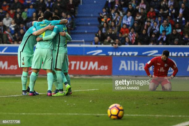 Barcelona's Brazilian forward Neymar celebrates a goal with teammates during the Spanish league football match Deportivo Alaves vs FC Barcelona at...
