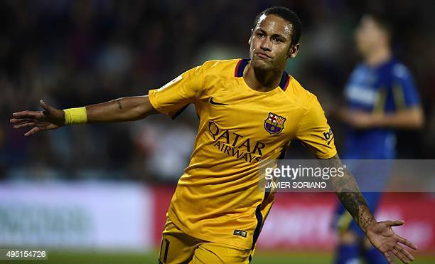 Barcelona's Brazilian forward Neymar celebrates after scoring a goal during the Spanish league football match Getafe CF vs FC Barcelona at the...
