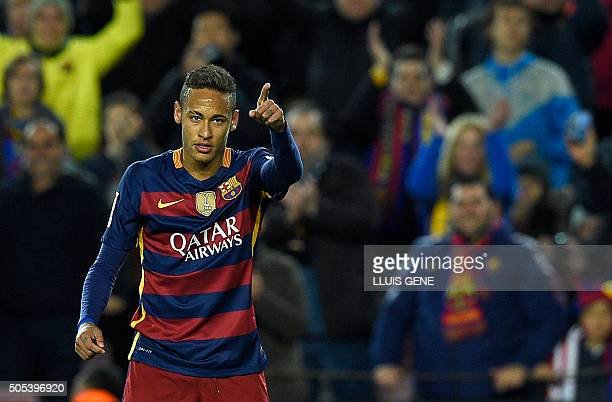Barcelona's Brazilian forward Neymar celebrates after scoring a goal during the Spanish league football match FC Barcelona vs Athletic Club Bilbao at...