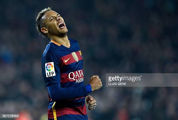Barcelona's Brazilian forward Neymar celebrates after scoring a goal during the Spanish Copa del Rey quarterfinals second leg football match FC...