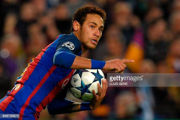 Barcelona's Brazilian forward Neymar celebrates after scoring a goal during the UEFA Champions League round of 16 second leg football match FC...