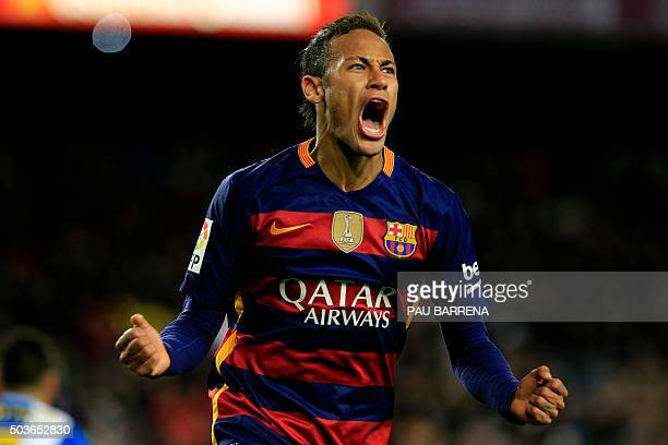 TOPSHOT Barcelona's Brazilian forward Neymar celebrates after scoring during the Spanish Copa del Rey round of 16 first leg football match FC...