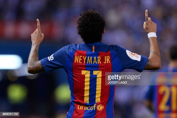 Barcelona's Brazilian forward Neymar celebrates after scoring during the Spanish Copa del Rey final football match FC Barcelona vs Deportivo Alaves...