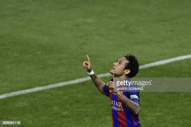 Barcelona's Brazilian forward Neymar celebrates after scoring their second goal during the Spanish Copa del Rey final football match FC Barcelona vs...