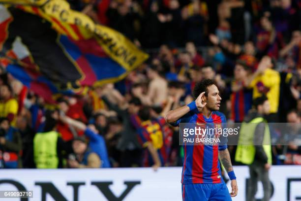 Barcelona's Brazilian forward Neymar celebrates at the end of the UEFA Champions League round of 16 second leg football match FC Barcelona vs Paris...