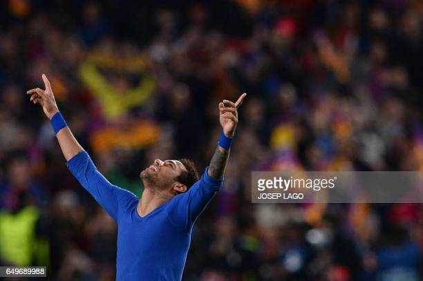 Barcelona's Brazilian forward Neymar celebrates their 61 victory at the end of the UEFA Champions League round of 16 second leg football match FC...