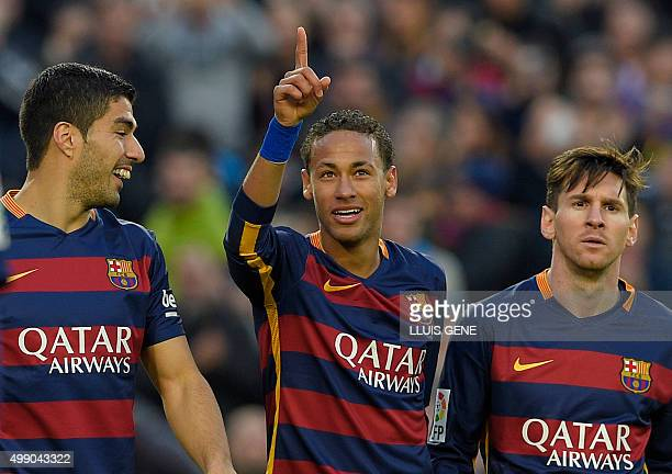 Barcelona's Brazilian forward Neymar celebrates with Barcelona's Uruguayan forward Luis Suarez and Barcelona's Argentinian forward Lionel Messi after...