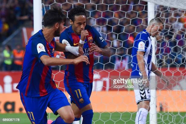 Barcelona's Brazilian forward Neymar celebrates with Barcelona's Portuguese midfielder Andre Gomes after scoring during the Spanish Copa del Rey...
