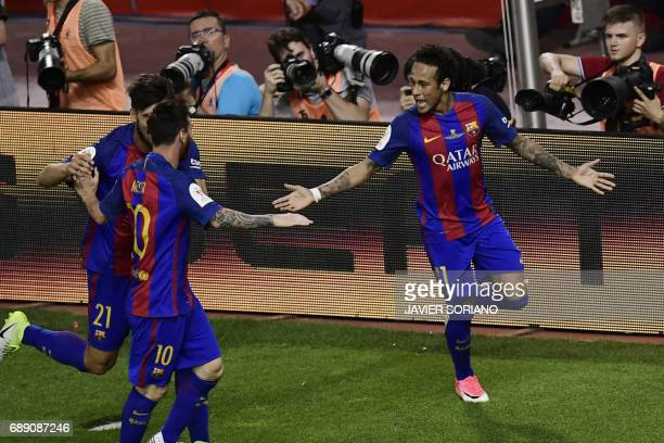 Barcelona's Brazilian forward Neymar celebrates with Barcelona's Portuguese midfielder Andre Gomes and Barcelona's Argentinian forward Lionel Messi...