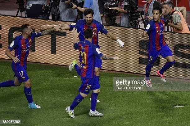 Barcelona's Brazilian forward Neymar celebrates with Barcelona's Portuguese midfielder Andre Gomes Barcelona's forward Paco Alcacer and Barcelona's...
