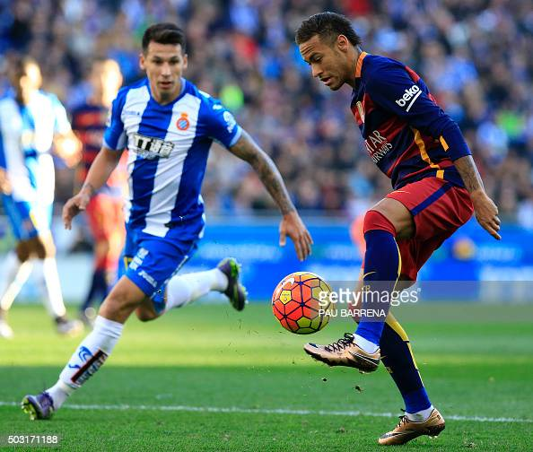 Barcelona's Brazilian forward Neymar controls the ball past RCD Espanyol's Paraguayan midfielder Hernan Perez during the Spanish league football...