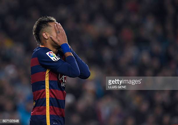Barcelona's Brazilian forward Neymar covers his face after missing an attempt on goal during the Spanish Copa del Rey quarterfinals second leg...