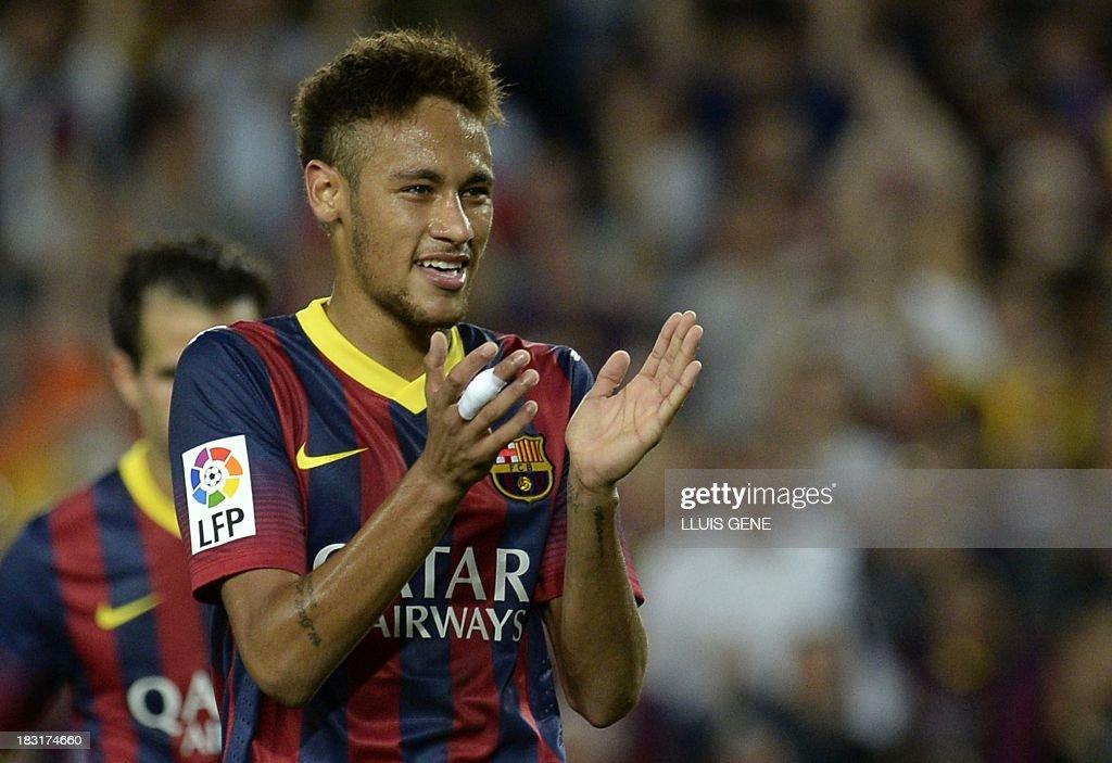 Barcelona's Brazilian forward Neymar da Silva Santos applauds during the Spanish league football match FC Barcelona vs Real Valladolid CF at the Camp Nou stadium in Barcelona on October 5, 2013.
