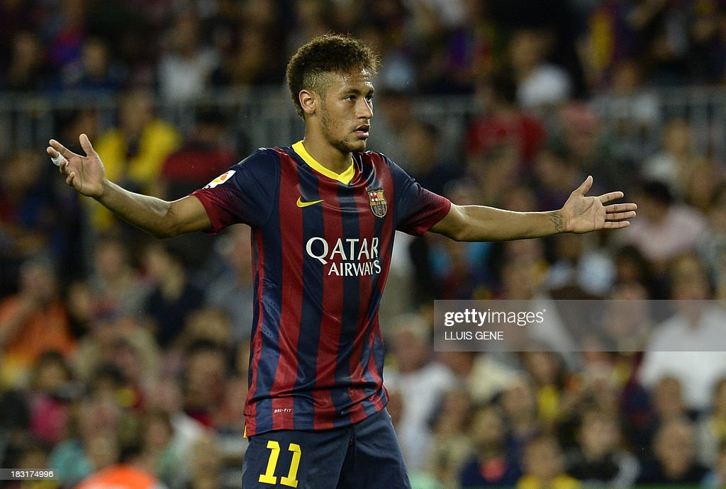Barcelona's Brazilian forward Neymar da Silva Santos argues with the referee during the Spanish league football match FC Barcelona vs Real Valladolid CF at the Camp Nou stadium in Barcelona on October 5, 2013.
