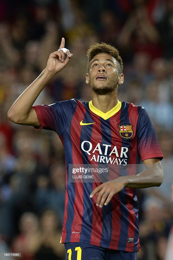 Barcelona's Brazilian forward Neymar da Silva Santos celebrates after scoring during the Spanish league football match FC Barcelona vs Real Valladolid CF at the Camp Nou stadium in Barcelona on October 5, 2013.
