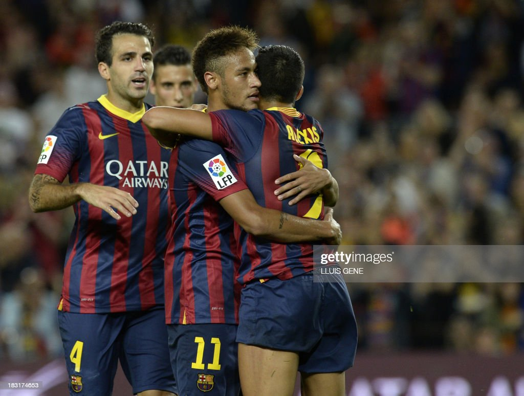 Barcelona's Brazilian forward Neymar da Silva Santos (C) celebrates with his teammates after scoring during the Spanish league football match FC Barcelona vs Real Valladolid CF at the Camp Nou stadium in Barcelona on October 5, 2013.