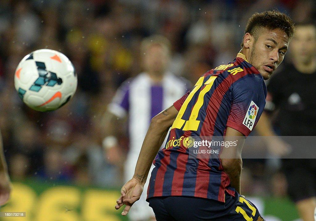Barcelona's Brazilian forward Neymar da Silva Santos eyes the ball during the Spanish league football match FC Barcelona vs Real Valladolid CF at the Camp Nou stadium in Barcelona on October 5, 2013.