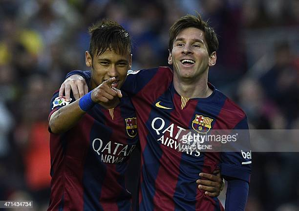 Barcelona's Brazilian forward Neymar da Silva Santos Junior and Barcelona's Argentinian forward Lionel Messi celebrate after scoring a goal during...