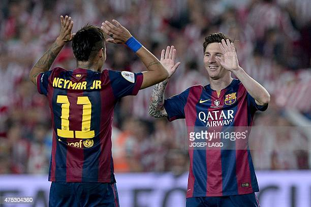 Barcelona's Brazilian forward Neymar da Silva Santos Junior and Barcelona's Argentinian forward Lionel Messi celebrate their victory at the end of...