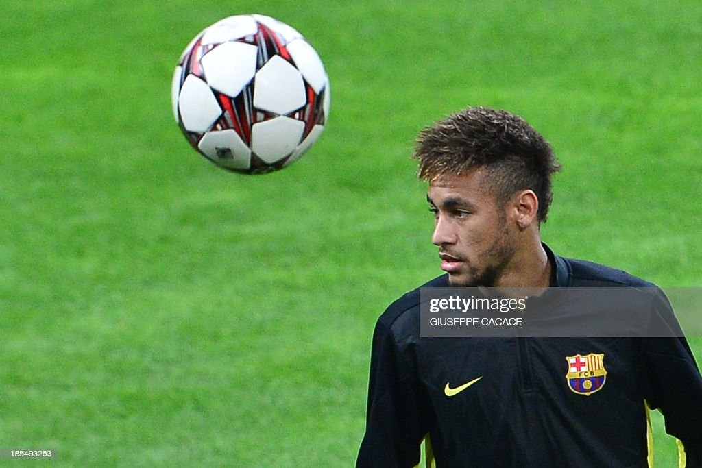 Barcelona's Brazilian forward Neymar da Silva Santos Junior attends a training session, on the eve of Champions League football match between AC Milan and FC Barcelona, on October 21, 2013 at the San Siro Stadium in Milan. AFP PHOTO / GIUSEPPE CACACE