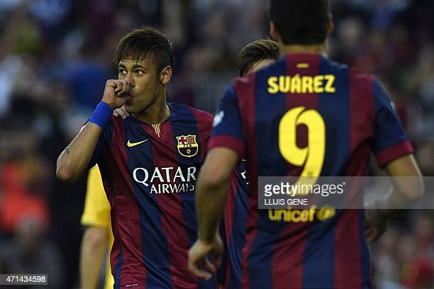 Barcelona's Brazilian forward Neymar da Silva Santos Junior Barcelona's Argentinian forward Lionel Messi and Barcelona's Uruguayan forward Luis...