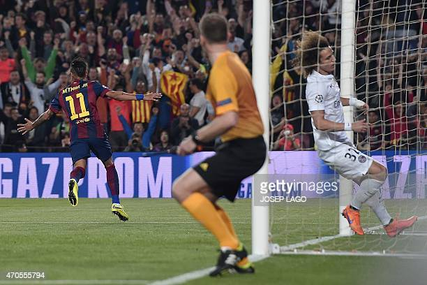 Barcelona's Brazilian forward Neymar da Silva Santos Junior celebrates his opener during the UEFA Champions League quarterfinals second leg football...