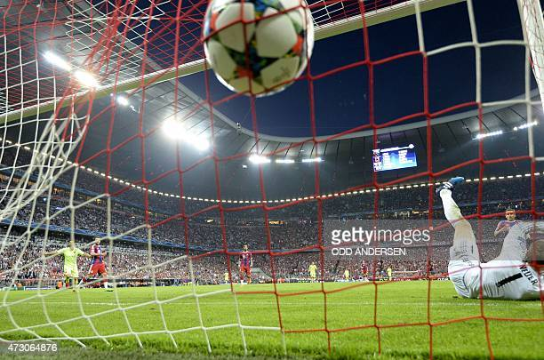 Barcelona's Brazilian forward Neymar da Silva Santos Junior celebrates scoring his second goal past Bayern Munich's goalkeeper Manuel Neuer during...
