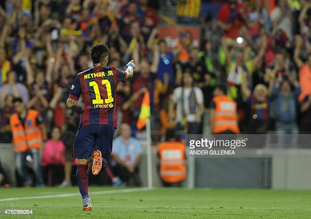 Barcelona's Brazilian forward Neymar da Silva Santos Junior celebrates after scoring during the Spanish Copa del Rey final football match Athletic...