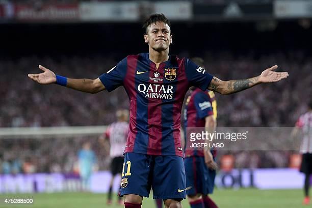 Barcelona's Brazilian forward Neymar da Silva Santos Junior celebrates his goal after scoring during the Spanish Copa del Rey final football match...