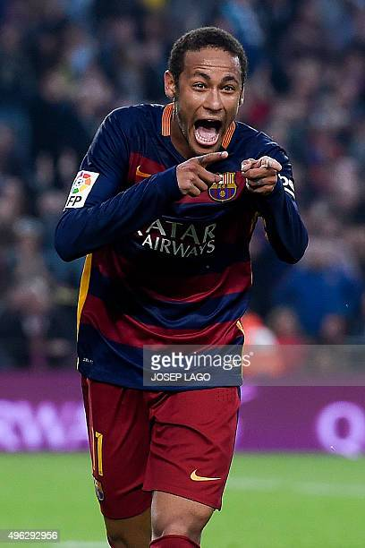 Barcelona's Brazilian forward Neymar da Silva Santos Junior celebrates his goal during the Spanish league football match FC Barcelona vs Villarreal...