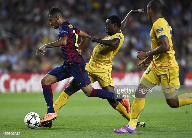 Barcelona's Brazilian forward Neymar da Silva Santos Junior vies with Apoel's Brazilian midfielder Vinicius during the UEFA Champions League football...