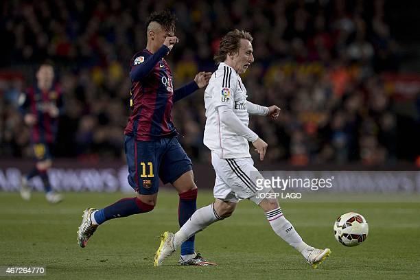 Barcelona's Brazilian forward Neymar da Silva Santos Junior vies with Real Madrid's Croatia's midfielder Luka Modric during the 'clasico' Spanish...