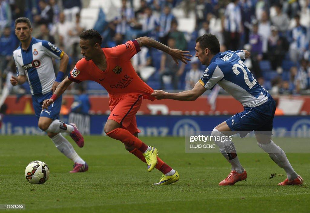 Barcelona's Brazilian forward <a gi-track='captionPersonalityLinkClicked' href=/galleries/search?phrase=Neymar+da+Silva&family=editorial&specificpeople=5766731 ng-click='$event.stopPropagation()'>Neymar da Silva</a> Santos Junior (L) vies with Espanyol's defender <a gi-track='captionPersonalityLinkClicked' href=/galleries/search?phrase=Alvaro+Gonzalez+-+Soccer+Player&family=editorial&specificpeople=2261829 ng-click='$event.stopPropagation()'>Alvaro Gonzalez</a> (R) during the Spanish league football match RCD Espanyol v FC Barcelona atthe Cornella-El Prat stadium in Cornella de Llobregat on April 25, 2015.