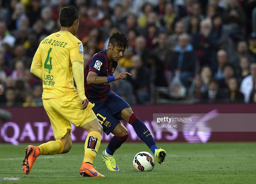 Barcelona's Brazilian forward <a gi-track='captionPersonalityLinkClicked' href=/galleries/search?phrase=Neymar+da+Silva&family=editorial&specificpeople=5766731 ng-click='$event.stopPropagation()'>Neymar da Silva</a> Santos Junior (R) vies with Getafe's Uruguayan defender Emiliano Velazquez (R) during the Spanish league football match FC Barcelona vs Getafe at the Camp Nou stadium in Barcelona on April 28, 2015. AFP PHOTO/ LLUIS GENE