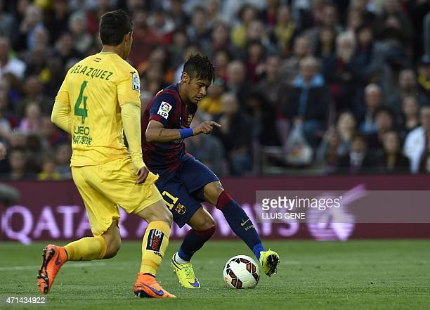 Barcelona's Brazilian forward Neymar da Silva Santos Junior vies with Getafe's Uruguayan defender Emiliano Velazquez during the Spanish league...