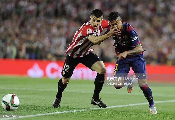 Barcelona's Brazilian forward Neymar da Silva Santos Junior vies with Athletic Bilbao's defender Unai Bustinza during the Spanish Copa del Rey final...