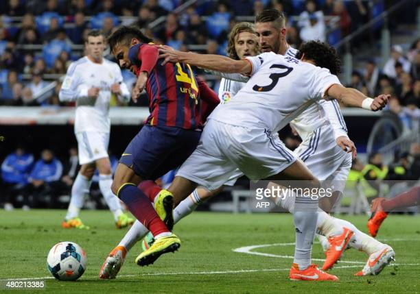 Barcelona's Brazilian forward Neymar da Silva Santos Junior vies with Real Madrid's defender Sergio Ramos and Real Madrid's Portuguese defender Pepe...