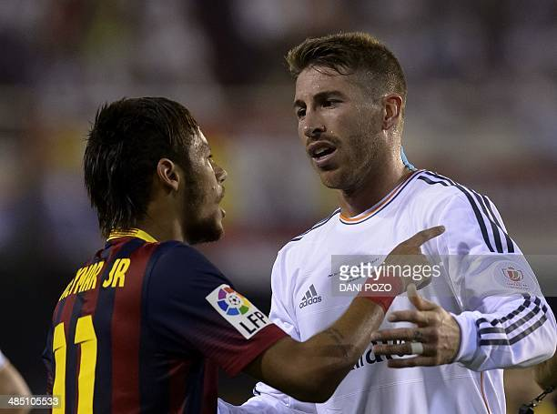 Barcelona's Brazilian forward Neymar da Silva Santos Junior vies with Real Madrid's defender Sergio Ramos during the Spanish Copa del Rey final...