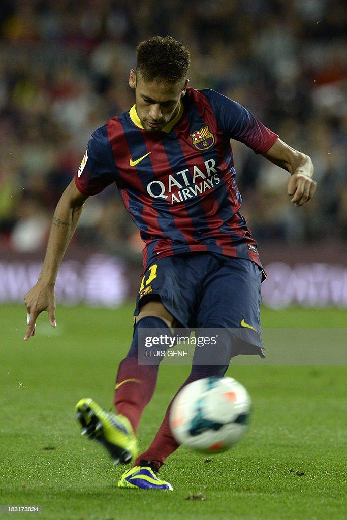 Barcelona's Brazilian forward Neymar da Silva Santos kicks the ball during the Spanish league football match FC Barcelona vs Real Valladolid CF at the Camp Nou stadium in Barcelona on October 5, 2013.