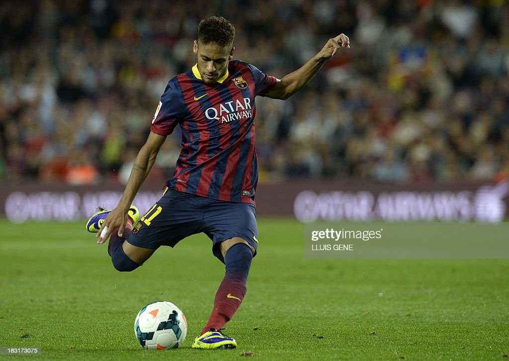 Barcelona's Brazilian forward Neymar da Silva Santos kicks the ball during the Spanish league football match FC Barcelona vs Real Valladolid CF at the Camp Nou stadium in Barcelona on October 5, 2013. AFP PHOTO / LLUIS GENE