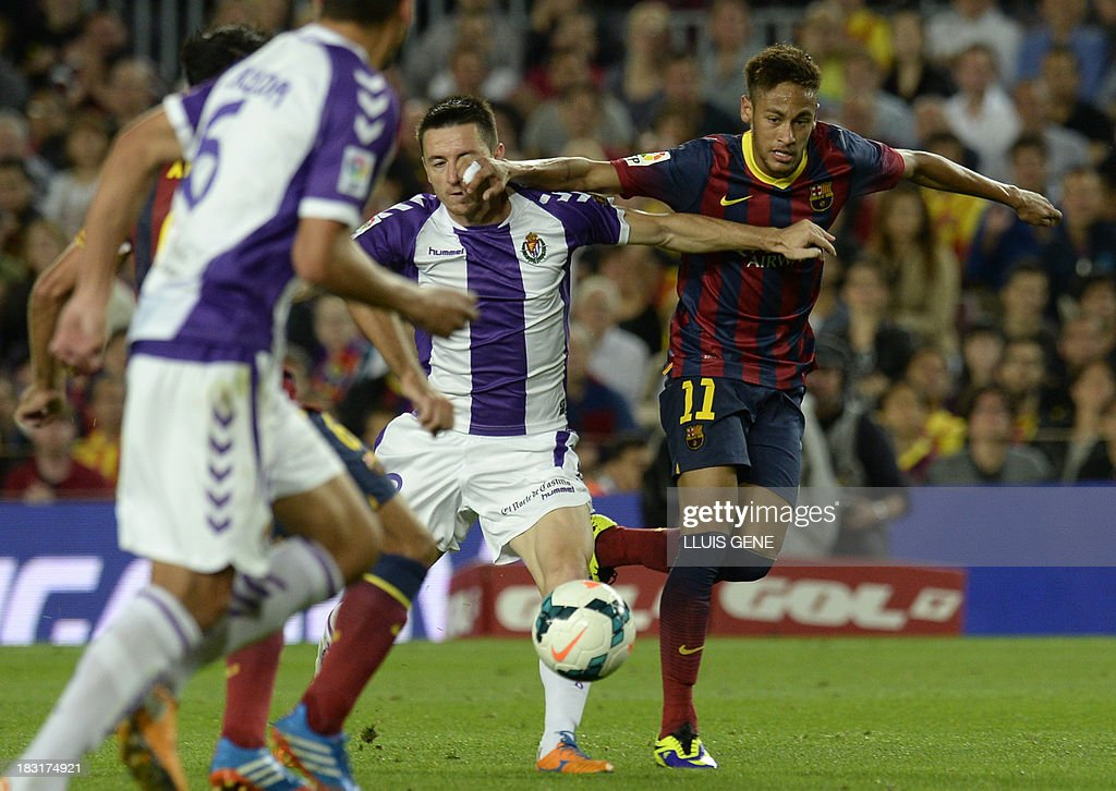 Barcelona's Brazilian forward Neymar da Silva Santos (R) vies with Valladolid's Serbian defender Antonio Rukavina during the Spanish league football match FC Barcelona vs Real Valladolid CF at the Camp Nou stadium in Barcelona on October 5, 2013.
