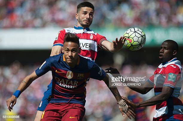 Barcelona's Brazilian forward Neymar da Silva vies with Granada's midfielder Fran Rico and French defender Jean Sylvain Babin during the Spanish...