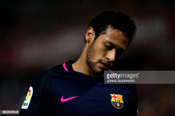 Barcelona's Brazilian forward Neymar da Silva walks during the Spanish league football match Granada FC vs FC Barcelona at Nuevo Los Carmenes stadium...