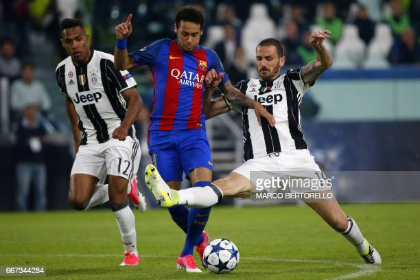 TOPSHOT Barcelona's Brazilian forward Neymar fights for the ball with Juventus' defender from Brazil Alex Sandro and Juventus' defender from Italy...