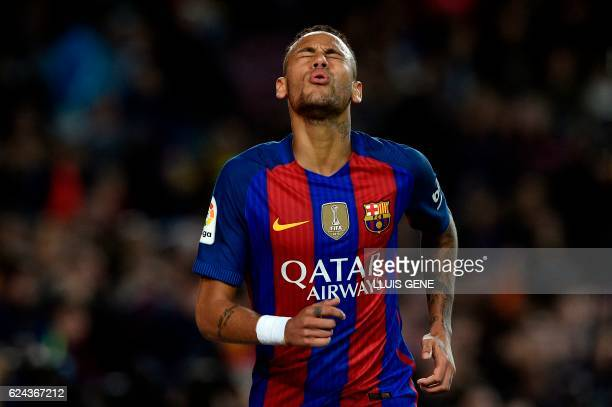 TOPSHOT Barcelona's Brazilian forward Neymar gestures during the Spanish league football match FC Barcelona vs Malaga CF at the Camp Nou stadium in...