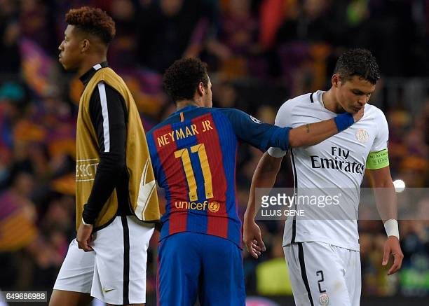 Barcelona's Brazilian forward Neymar greets Paris SaintGermain's Brazilian defender Thiago Silva during the UEFA Champions League round of 16 second...